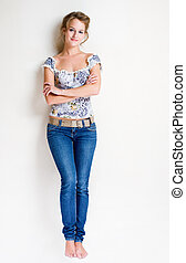 Confident young blond woman. - Full length portrait of a...