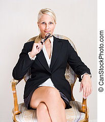 Rich business woman - Portrait od friendly attractive blond...