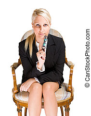 Attentive business woman sitting in antique chair