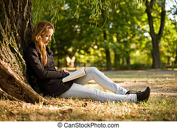 Enjoy a good book anywhere. - Portrait of beautiful young...