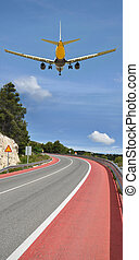 Airplane Flying over Highway Curve - Empty Highway with...
