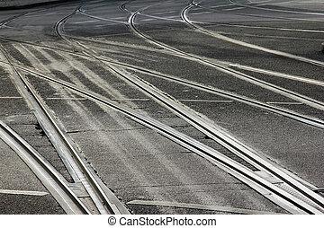 Tramlines - Silvery grey tramlines criss-cross streets in...