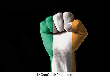 Fist painted in colors of ireland flag - Low key picture of...