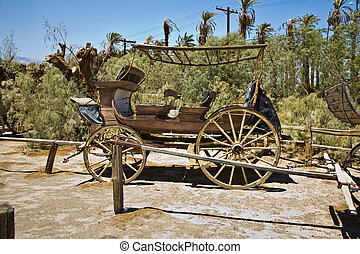 old wagon and coaches at the entrance of the Furnance Creek...