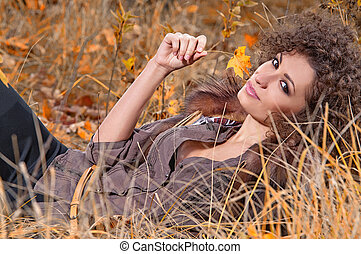 Young cheerful woman outdoors - Outdoors portrait of...