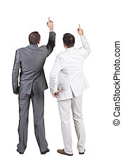 Back view of two businessman pointing at wall. rear view....