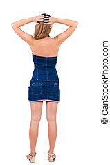 Back view of shocked and scared young beautiful woman.