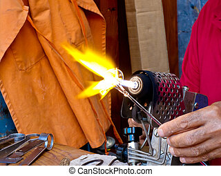Artisan Working With Blowtorch - Close up of the hand of a...