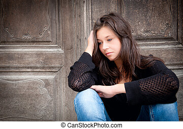 Teenage girl looking thoughtful about troubles - Outdoor...