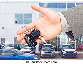 Car key. - Hands with car keys. Dealer and client.