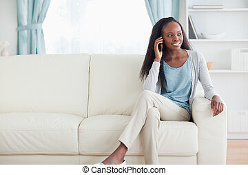 Woman with cellphone on couch