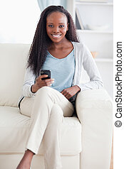 Woman happy about text message