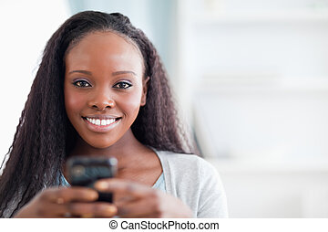 Close up of woman holding cellphone - Close up of smiling...
