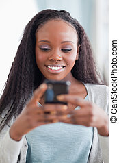 Close up of happy woman reading text message - Close up of...