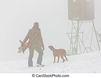 woman with her dog at hunt