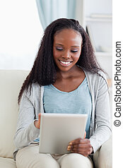 Close up of woman using her tablet on couch