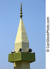 Minaret - Local mosque in showing public address system to...