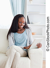 Close up of woman with tablet on couch