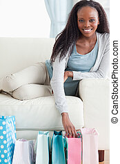 Close up of young woman happy about her shopping