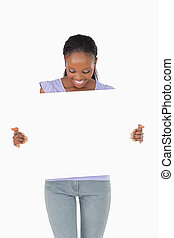 Close up of smiling woman looking at placeholder in her...