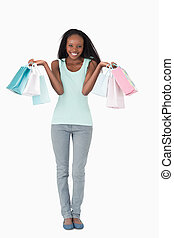 Woman happy about her shopping on white background