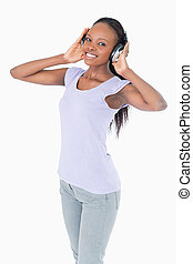 Close up of woman with headphones on white background
