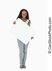 Woman holding placeholder on white background - Smiling...