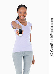 Close up of phone being presented by woman on white background