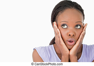 Close up of woman being afraid against a white background -...