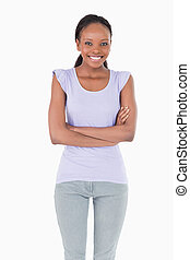 Close up of woman with arms folded on white background