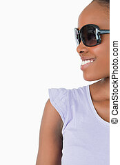 Close up of smiling woman with sunglasses on white background