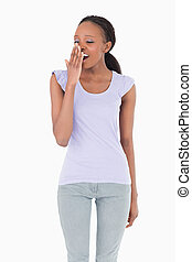 Close up of yawning woman on white background
