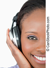 Close up of young woman with headphones on white background...