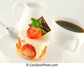 Cake from cream and a strawberry with mint, a cup of coffee