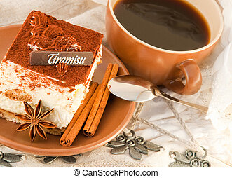 Cake tiramisu and a cup of hot coffee