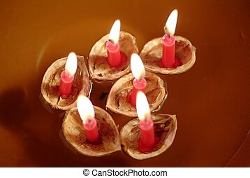 Christmas tradition - Walnut Shells with Candles Floating in...