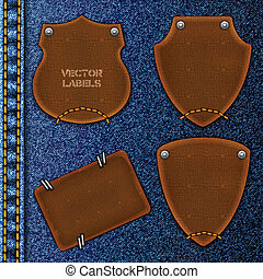 Leather labels against denim background.