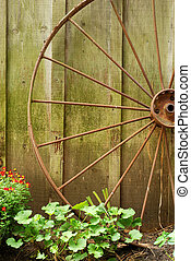 closeup old wagon wheel with flowers