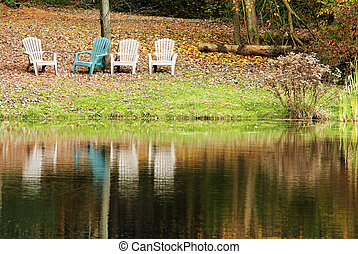 four chairs by the lake