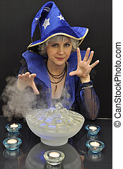 Witch in blue hat with magic crystals and candles - Witch in...