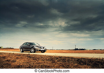 Car on country road - Modern luxury business sedan on...