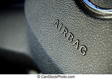Airbag symbol on steering wheel closeup