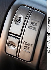 Cruise control buttons on a steering wheel