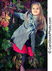 child fashion - Shot of a cute girl walking at the park....