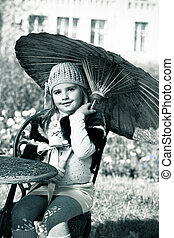 umbrella - Cute little girl having a rest at a park Retro...