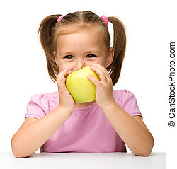 Little girl with yellow apple
