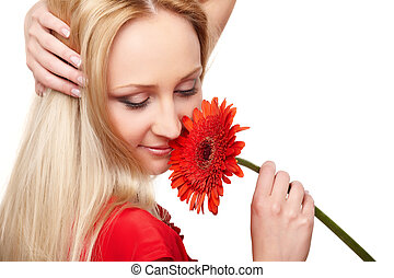Young lady with red gerbera