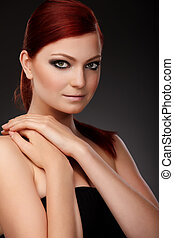 Red-haired beauty - Closeup portrait of a red-haired female...
