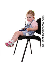 Small playful doctor - Small playful girl on chair with...