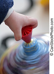 Toy - Child hand on spinner in motion